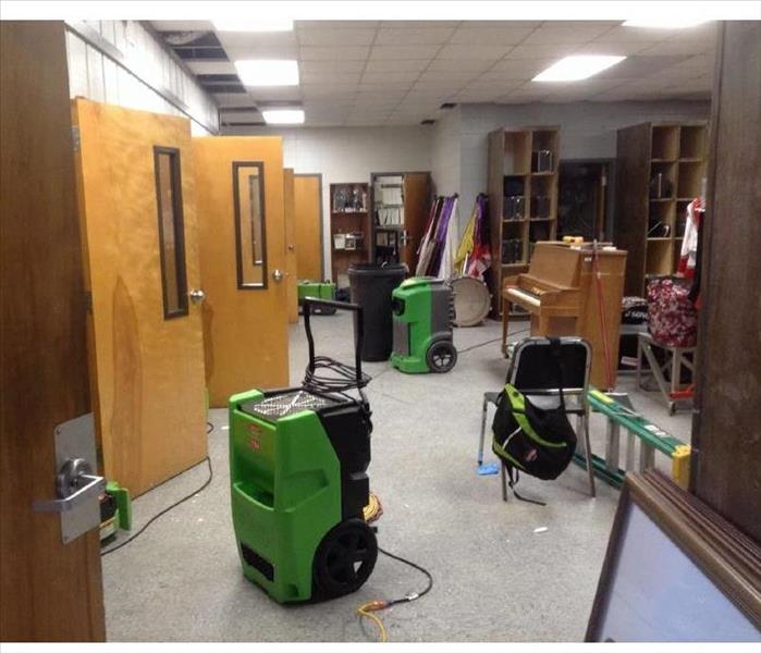 Commercial storm damage to High School Bandroom.  After